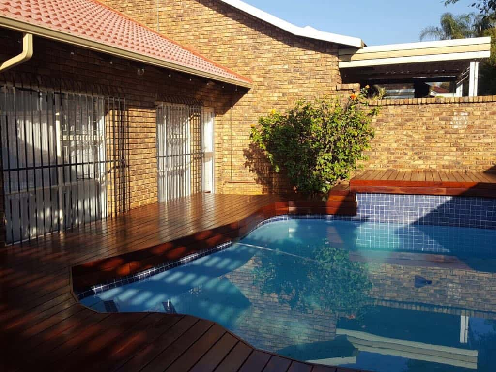 Teak Decking Contouring An Odd Shape Pool